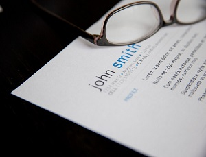 resume and eyeglass on a table