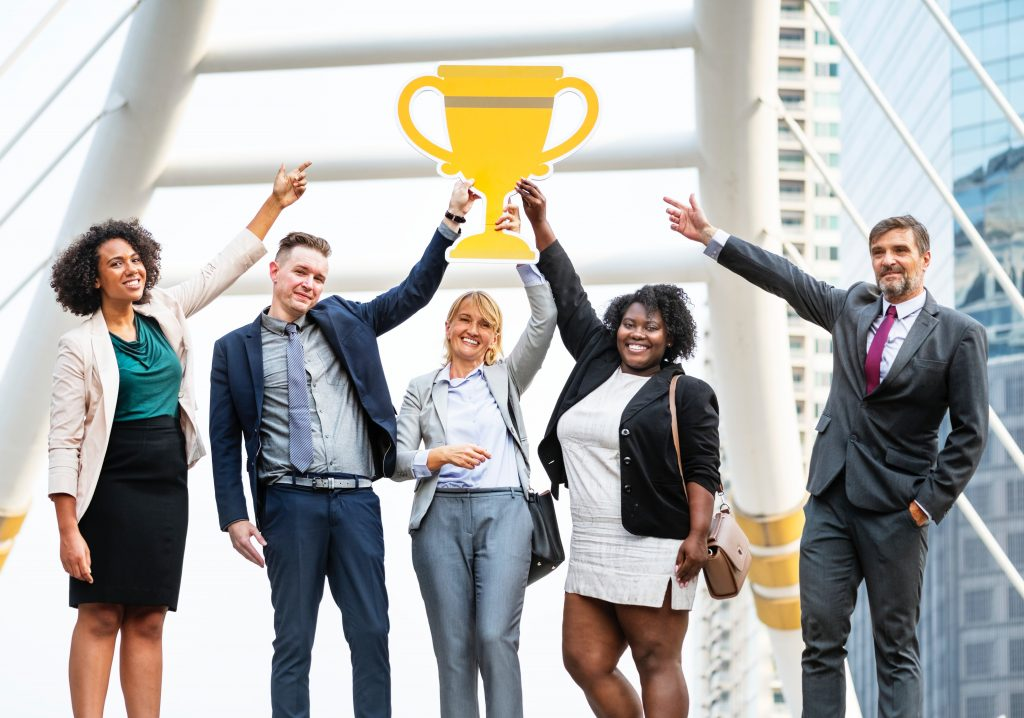 competitive resume your key to success five workers with a trophy on top