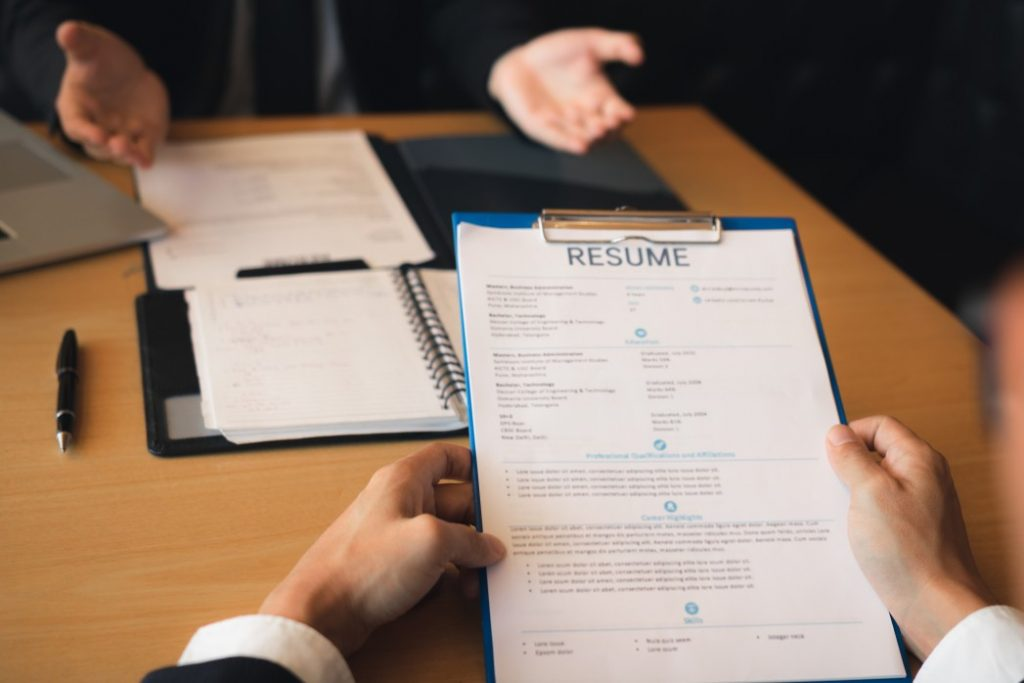 a person reading a good resume