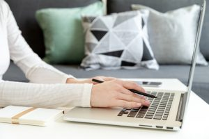 woman looking for best resume writing company using her laptop