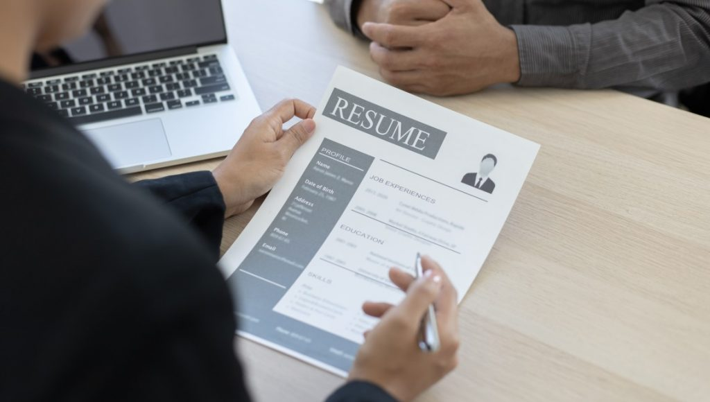 a hiring manager reading a great resume