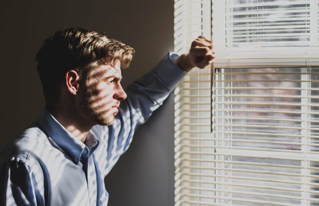 a man facing the window and considering to change career