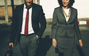 man and woman walking and talking - how to deal with your new boss