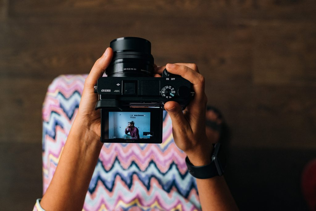 a girl holding a camera for resume formats