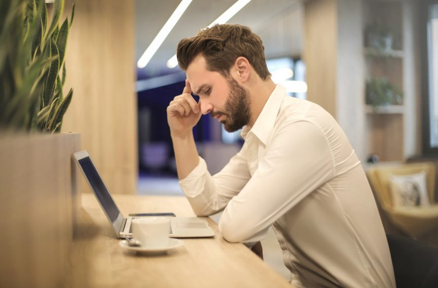 man thinking how to answer top job interview question