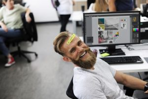 man happy about his creative employee benefits