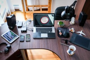 Tools and Apps for Jobseeker: Laptop, Cellphone, Gadgets on top of a table