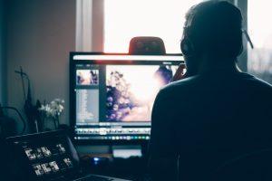 man editing video - freelance jobs