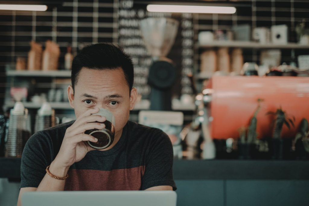 freelance jobs - man at work in a coffee shop