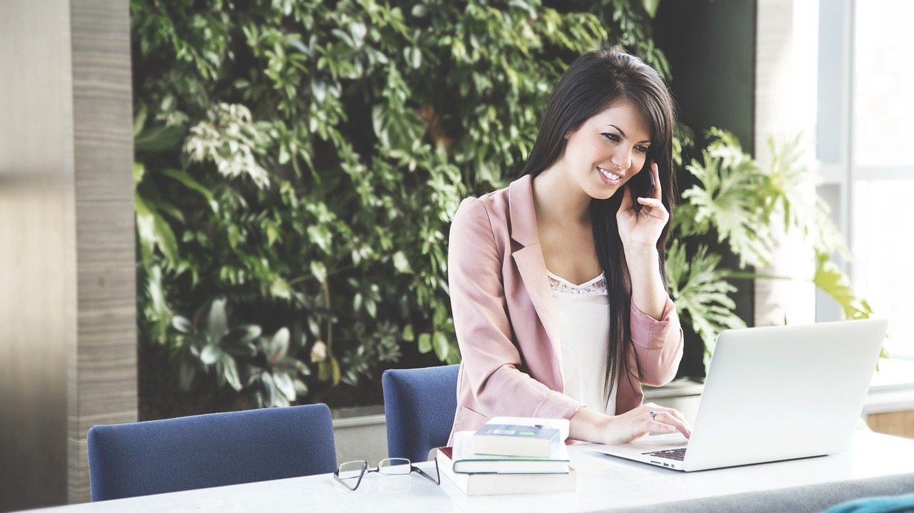 woman talking with certified resume writers on the phone
