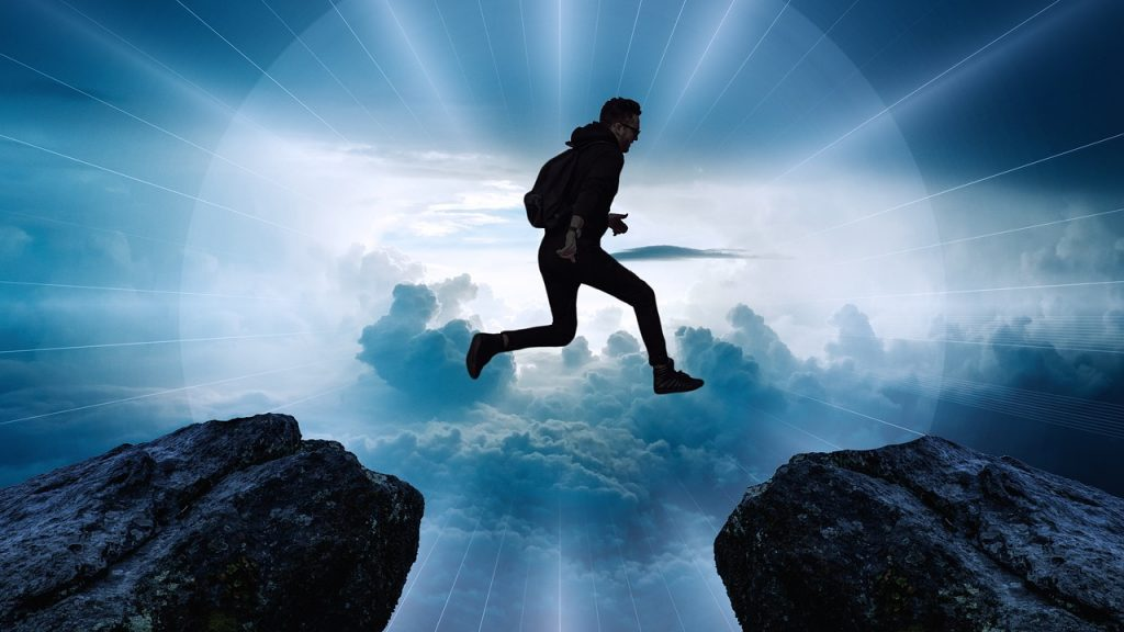 Man jumping from a rock to another depicting need for career change resume