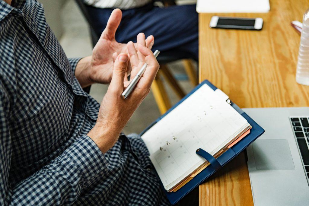 Man Holding a Pen: Operations Manager Job Description for Aspiring Job Applicants