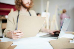 Artist drafting his creative resume