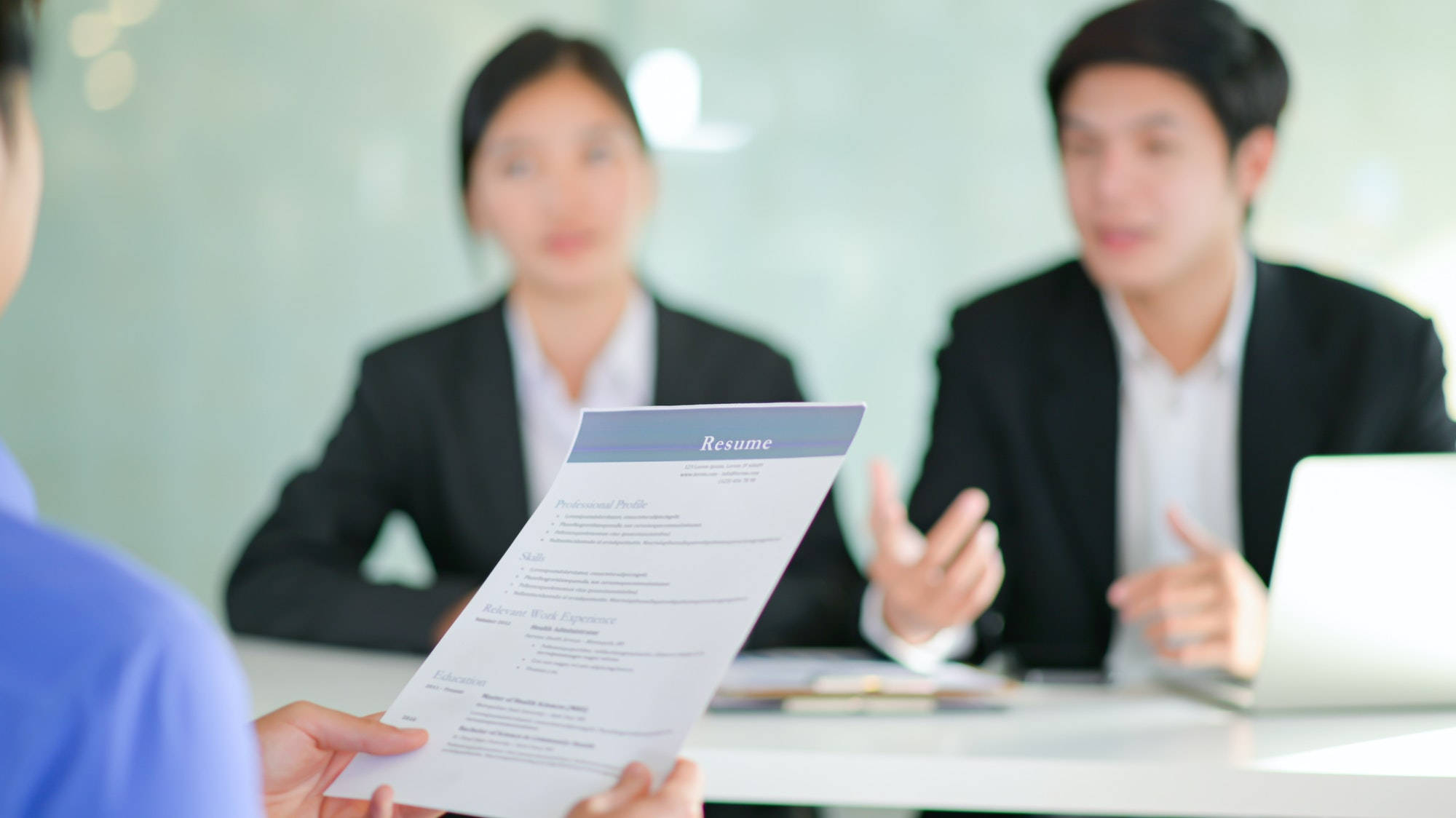 Interviewing job seekers presenting their resume with current resume trends