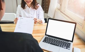 Young woman submit ATS resume to employer