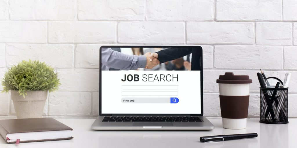 Pc on the desk with one of the job search sites on display