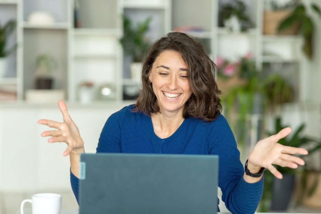 woman answering behavioral interview questions online